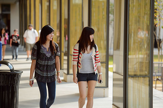 Students walk to classes in the new Business Education Complex. Photo by Jim Zietz.