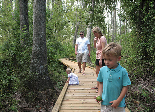 A family explores Black Swamp, a popular destination on the Trees & Trails route. Photo by Elma Sue McCallum
