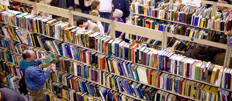 Book lovers peruse the selections at the 2013 Book Bazaar. Photo by Eddy Perez
