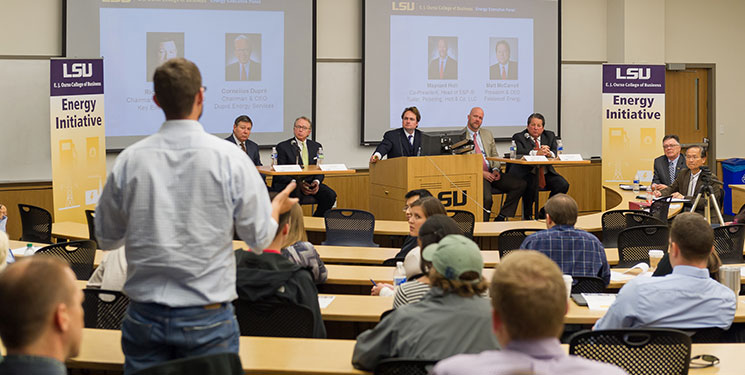 An engineering student poses a question to the Energy Executive Panel, part of the E. J. Ourso College of Business Energy Initiative. Photo by Brett Lovetro