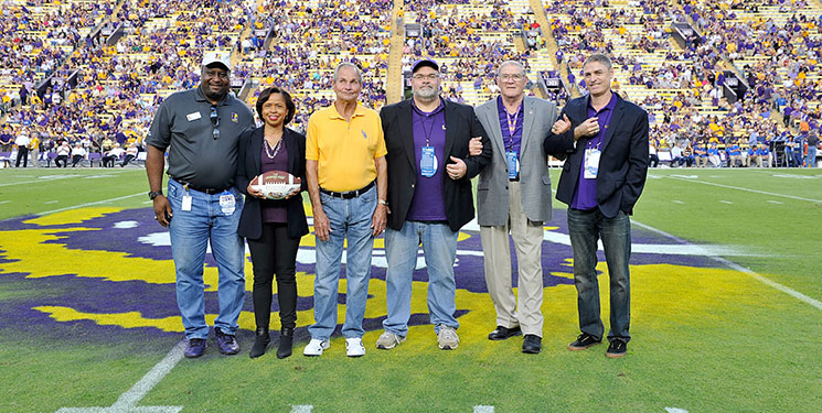 From left, Eric Reid Sr., representing the LSU National L Club; Terrie Sterling, representing game sponsor Our Lady of the Lake; Richard Granier, 1964 football MVP and guest captain; David Miller; Fred Miller, guest captain; and Jake Miller at the 2014 LSU football game against Kentucky.