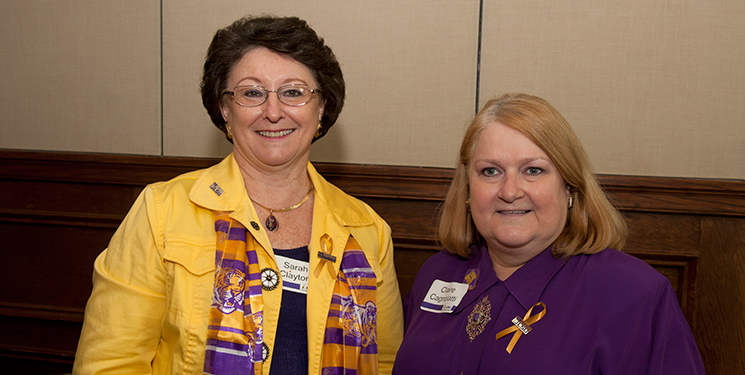 Claire Cagnolatti (right) with Sarah Clayton at a 2011 LSU Foundation tailgate reception.