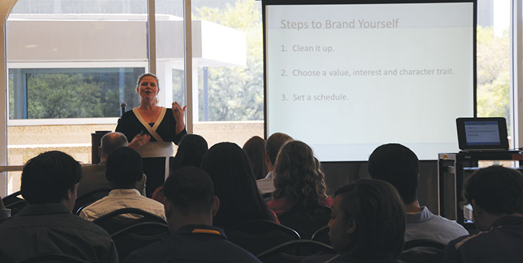 Stafford Kendall teaches Career and Leadership Seminar attendees how to market themselves for their future careers.