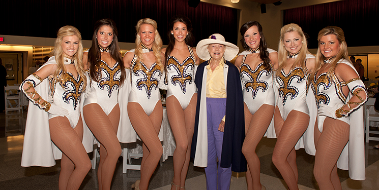 Sue Turner stands with LSU's Golden Girls at the 2012 Tiger Band Hall dedication.