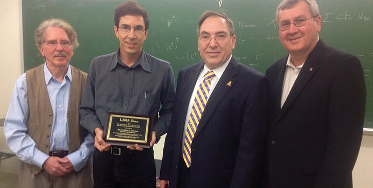 From left, Robert Perlis, chair of the Department of Mathematics; Stephen Shipman, associate professor of mathematics; Guillermo Ferreyra, interim dean of the College of Science; and Terry Latiolais, former chair of the College of Science Dean's Circle Executive Committee